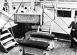 Injured soldier being winched on board hospital ship PLASSY in a makeshift stretcher