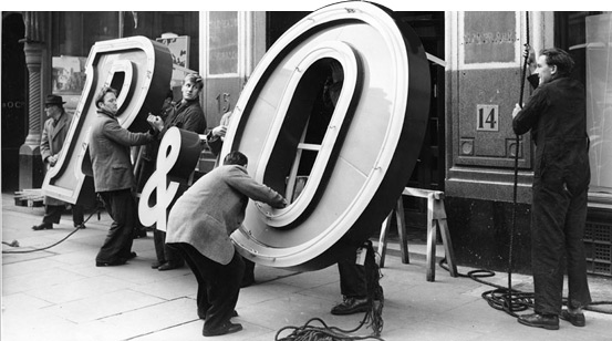 P&O neon sign being installed at the P&O Head Office at Cockspur Street in 1956