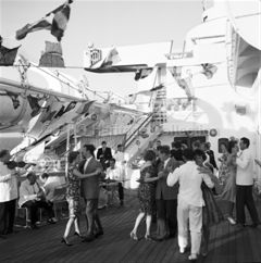Passengers dancing on deck onboard ORCADES