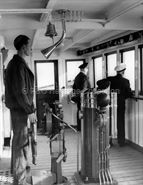 Crew on the bridge of  WOODLARK